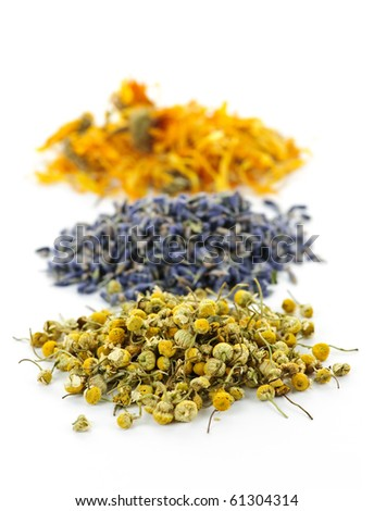 Piles of dried medicinal herbs camomile, lavender, calendula on white background - stock photo