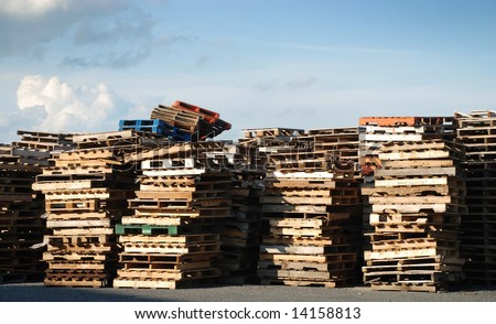 Piles of industrial wooden pallets - stock photo