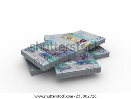 Piles of new Kuwaiti money isolated on white background  - stock photo