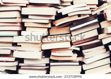 piles of old books in the flea market - stock photo