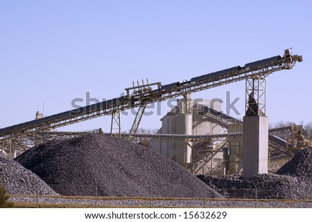 Piles of processed stone and conveyor belt.