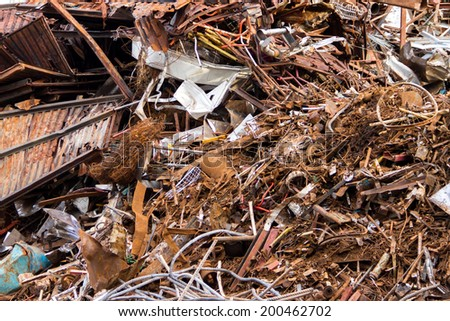 Piles of scrap metal bundled in bales for recycling