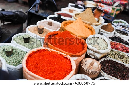 Piles of spices for sale. Indian market. New Delhi. - stock photo