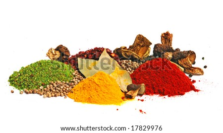 Piles of spices: parsley, red paprika, whole black pepper, white coriander, curcuma, laurel leaves and dry porcini mushrooms.