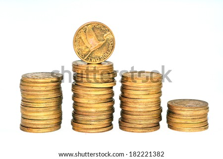 Piles of two New Zealand Dollar bank coins isolated on white background.Concept photo of money, banking ,currency and foreign exchange rates.  (Isolated on white background) - stock photo