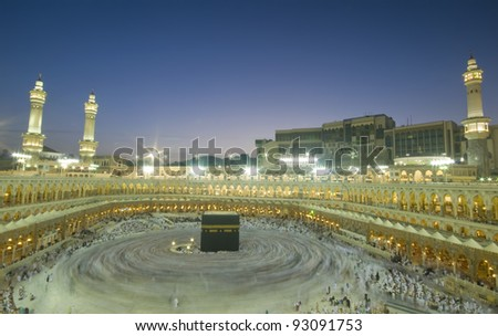 Pilgrims circumambulate the Kaaba at Masjidil Haram in Makkah, Saudi Arabia. Muslims all around the world face the Kaaba during prayer time. - stock photo