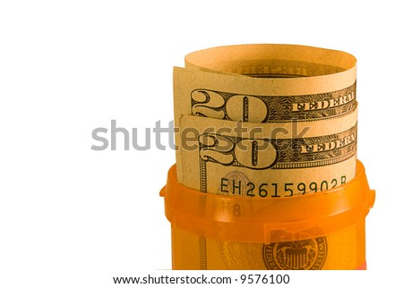 Pill bottle with money in it - stock photo