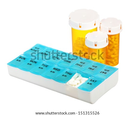 Pill bottles and medicine dose box  isolated on white background. Weekly dosage of medication in pill dispenser and three pill bottles  - stock photo