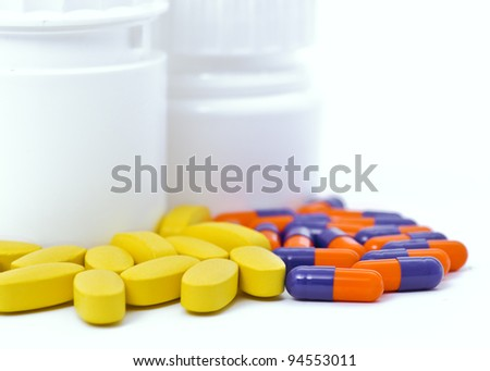 pill bottles with medicine out. white background - stock photo