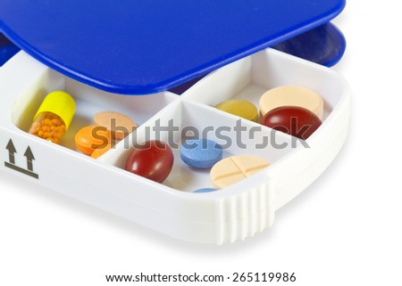 Pill Box with pills on bright background - stock photo