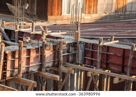 pillar and beam being constructed at the construction site - stock photo