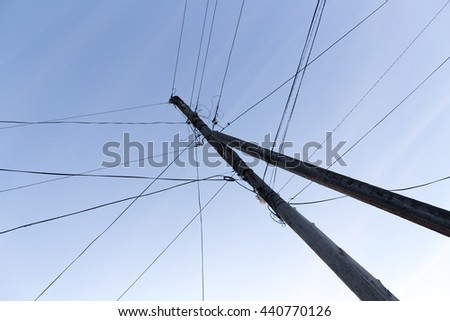 pillar with electric cables at dawn