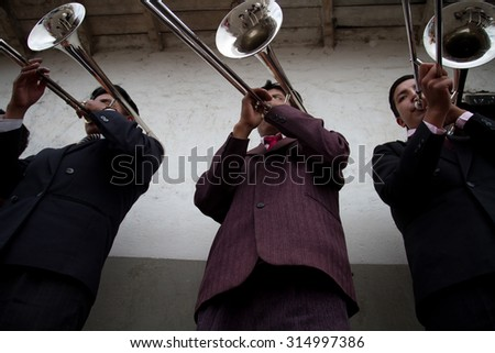 PILLARO, ECUADOR - JANUARY 4, 2014: Unknown local musicians playing in the Diablada, popular town celebrations with people dressed as devils dancing in the streets - stock photo