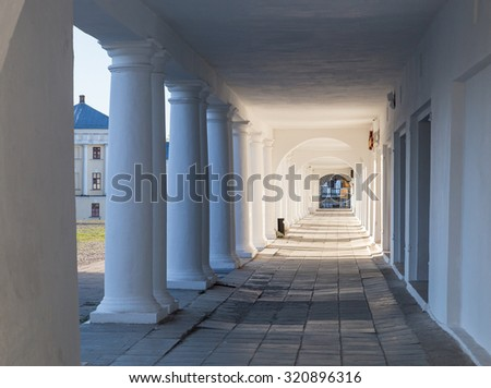 Pillars and Arch Hallway perspective Russia Suzdal - stock photo