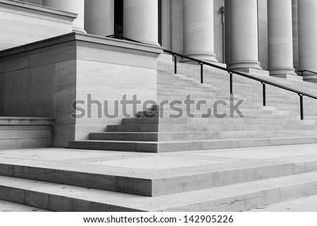 Pillars and Stairs leading up to a door - stock photo