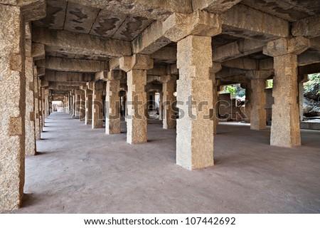 Pillars in the temple, Hampi, India - stock photo