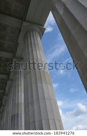 Pillars with Blue Sky and Clouds - stock photo