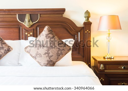 Pillow on bed with light lamp decoration in bedroom interior