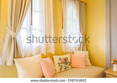 pillow on sofa and curtain in the room - stock photo