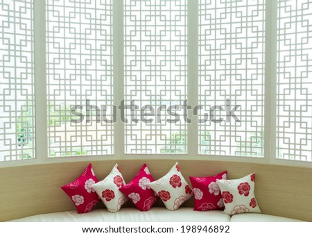 Pillow on sofa wallpaper chinese style background - stock photo