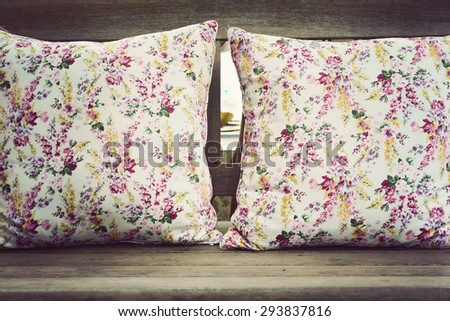 Pillow on wooden chair with vintage look - stock photo