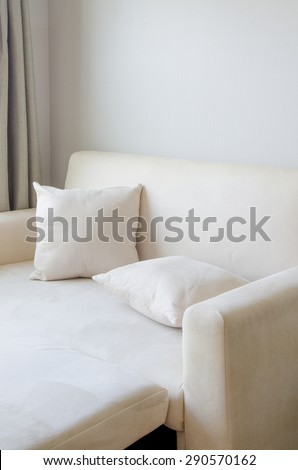 pillow placed on Sofa cream color in  The living room ,time for relax,break,relaxation