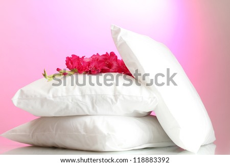 pillows and flower, on pink background - stock photo