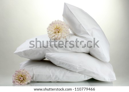 pillows and flowers, on grey background - stock photo