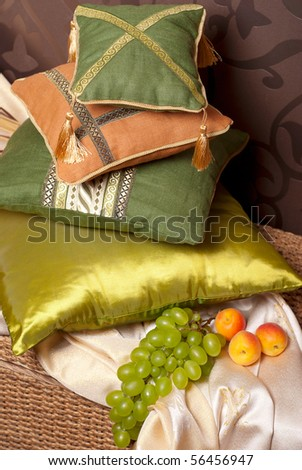 pillows in east interior with fruits - stock photo