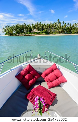 Pillows in speed boat, sea on background - stock photo