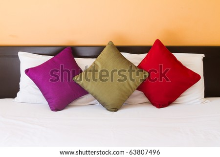 Pillows in three colors - stock photo