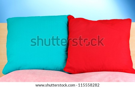 pillows on blue background - stock photo