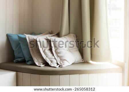 Pillows On Build-In Sofa In The Living Room With Sunlight From The Window - stock photo
