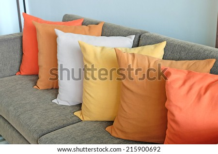 Pillows on sofa at home - stock photo
