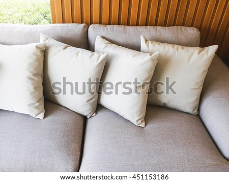 Pillows on sofa Home interior decoration background