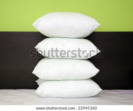Pillows on the bed - stock photo