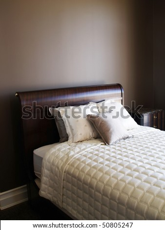 pillows on the bed in the brown bedroom - stock photo