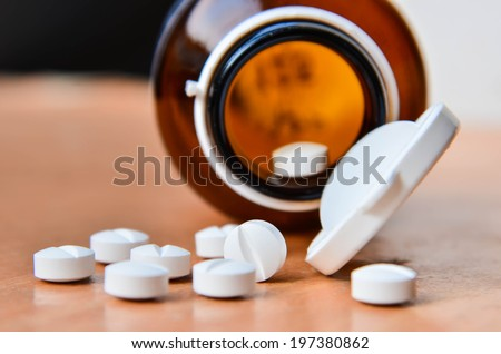 Pills and bottle. - stock photo