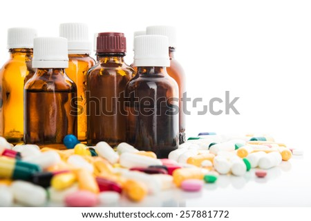 Pills and bottles isolated on white background - stock photo