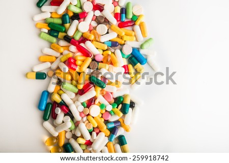 Pills and capsule on white background - stock photo