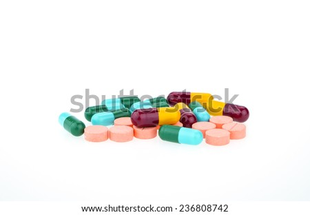 Pills and capsules, oral medicine isolated on white background - stock photo