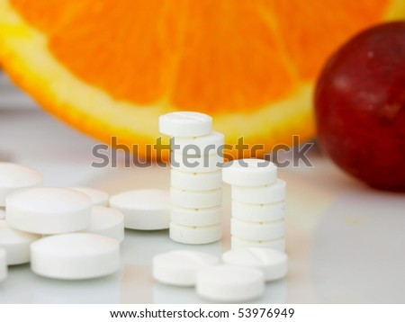 Pills and fruit
