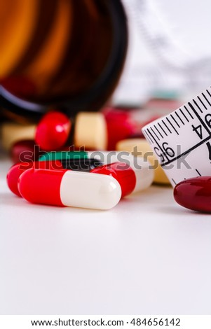 pills and pill bottle isolated on white background