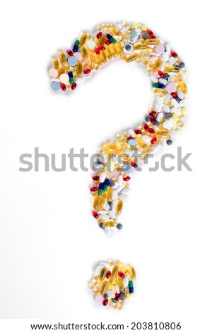 Pills as question mark on white background. Medical concept. - stock photo