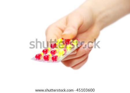 pills capsules of antibiotic in hand isolated on white - stock photo