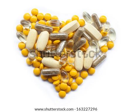 Pills in a heart shape - stock photo