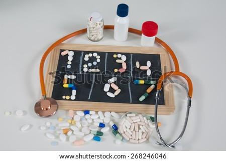 pills in blackboard  on white background - stock photo