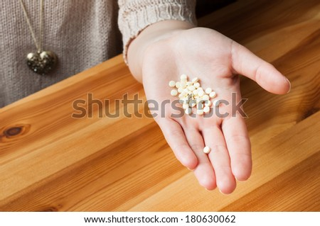 Pills in hand of young girl