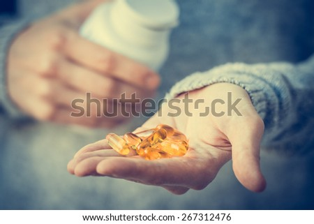 Pills in hands. Medicine and health care concept. Toned image - stock photo