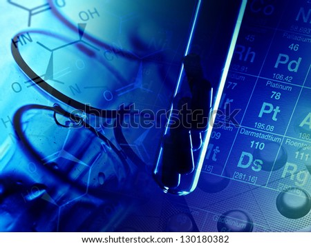 Pills in test tube over blue background. - stock photo